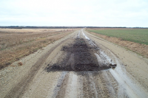Loader gouged road